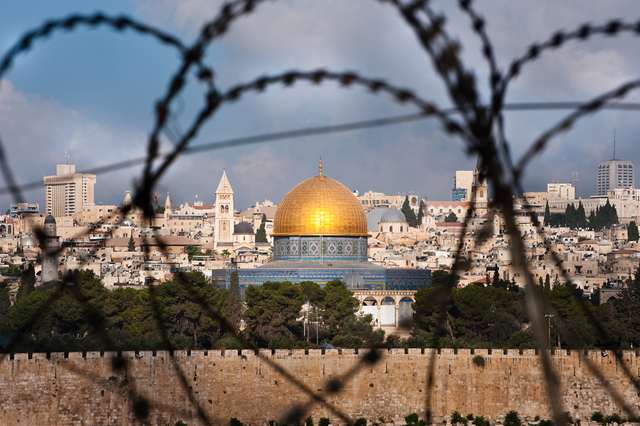 Jerusalem dome through barbed wire